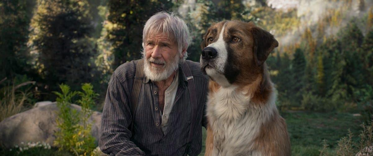 Harrison Ford mit CGI Hund Buck in der Wildnis.
