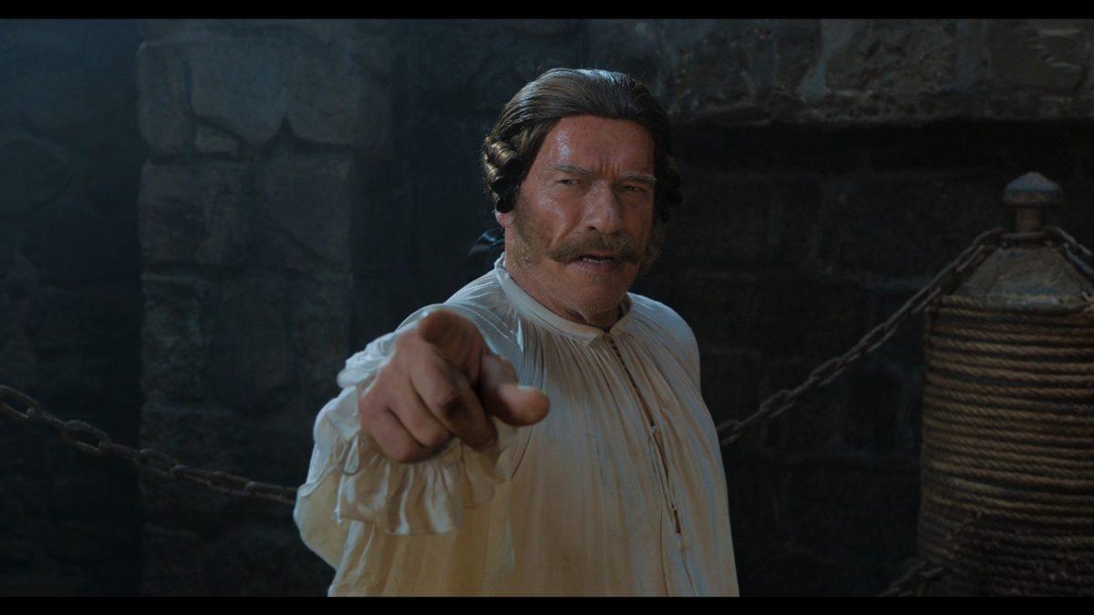 Arnold Schwarzenegger mit Perücke und Schnauzbart
