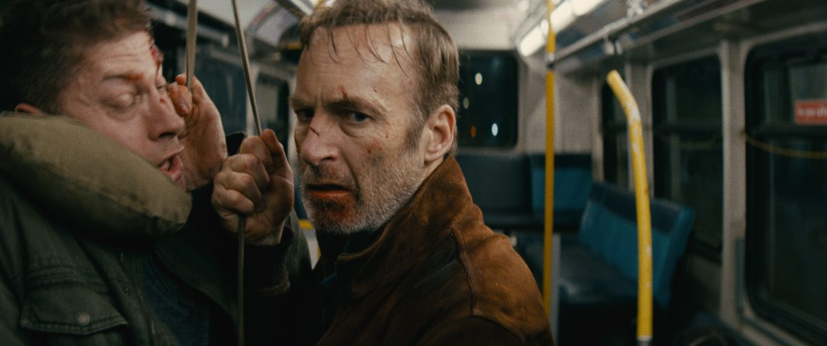 (L-R) Bus Pöbler (Alain Moussi) and Hutch Mansell (Bob Odenkirk) in Nobody